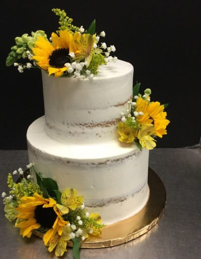 Christine's Cakes & Pastries - 2 Tier-Buttercream Nake Wedding Cake with sunflower accent