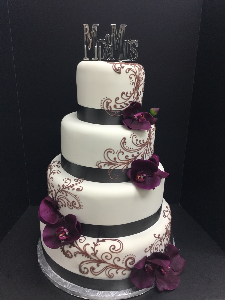 Christine's Cakes & Pastries - 4 Tier-Fondant Wedding Cake ribbon and detail scroll work (Gum paste flower Accent)