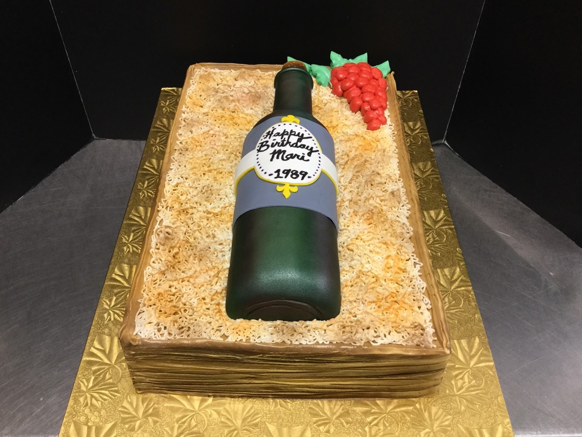 Christine's Cakes & Pastries - Sculpted Packaged Stella Artois Beer Bottle